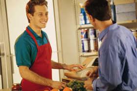 Cashier with customer at grocery store